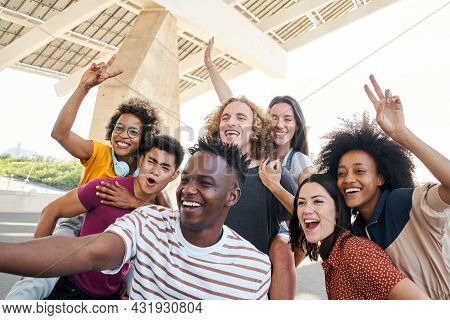 Group Of Friends Taking A Selfie And Having Fun In The City. Friendly Interracial Young People. Conc
