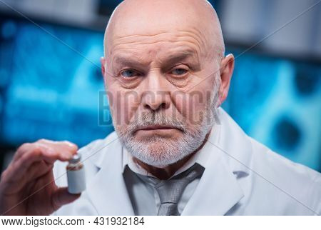 Professor works in a modern scientific laboratory using equipment and computer technologies. The scientist does research and develops new vaccines. Science and healthcare concept.