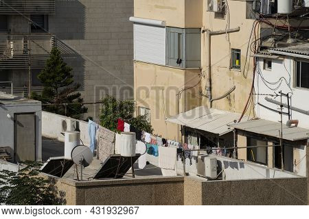A Typical View In Southern Tel Aviv, Israel, Including Laundry Hanging To Dry On A Rooftop, Old Sola