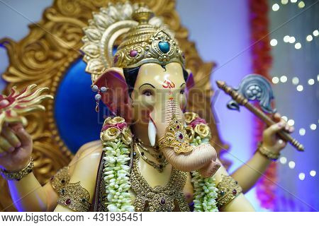Ganesha Festival, Lord Ganesha Statue On Colorful Background With Jewellery