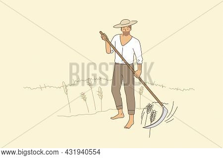 Farming And Rural Agriculture Concept. Young Smiling Man Farmer In Hat Barefoot Standing Mowing Rye