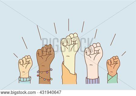 Equal Rights And Stop Racism Concept. Hands Of Mixed Race People Group Showing Fists Meaning Equalit
