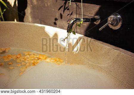 Hot Water, Foam, Rose Petals In Bath Tub Outdoors.