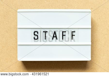 Lightbox With Word Staff On Wood Background