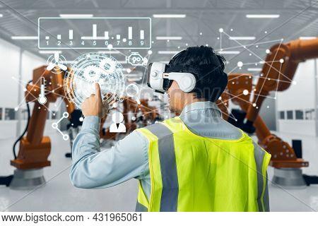 Behind Asian Man Engineer Worker Wearing Vr Headset Working Control Robotic  Industrial In Factory.