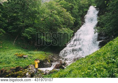 Gudvangen-naeroyfjorden, Norway. Waterfall Tuftofossen In Spring. Natural Norwegian Landmark. Young