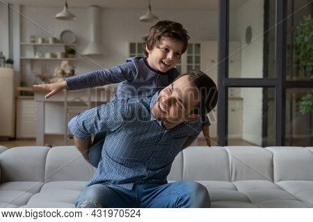 Happy Loving Daddy And Affectionate Boy Playing Active Games