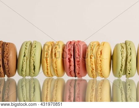 Macaron. Macaroons  Cakes. Colorful french macarons on background