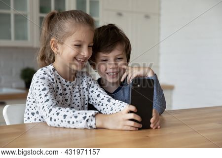Happy Excited Sibling Gen Z Kids Using Smartphone Together