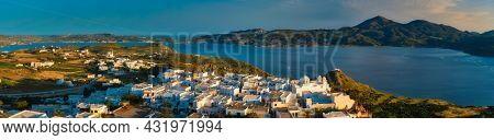 Panorama of Plaka village on Milos island with traditional greek white houses on sunset. Plaka town, Milos island, Greece