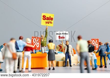 Shoppers With Discount Tray For Shopping Discounted Items ,  Black Friday Concept