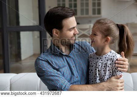 Happy Millennial Affectionate Daddy Hugging Daughter Girl With Love