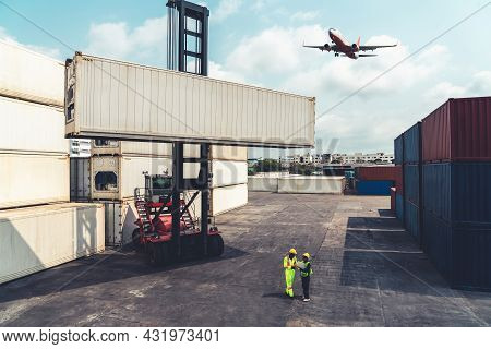 Industrial Worker Works With Co-worker At Overseas Shipping Container Port . Logistics Supply Chain