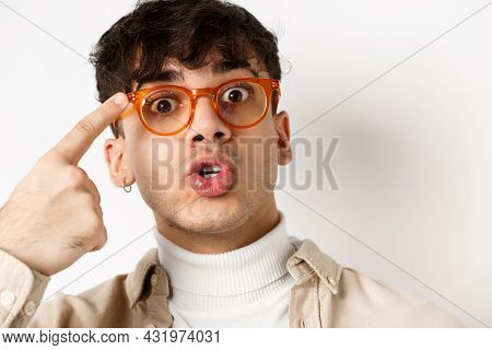 Close-up Of Cute And Funny Guy In Glasses Pointing At Eyewear Frames, Recommending Optic Store, Stan