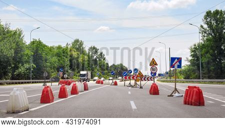 Warning Signs On A Dangerous Section Of The Road Showing Directions Of Traffic. Roadworks
