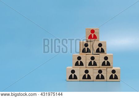 Human Resource. Boss Icon On Wooden Cube Block On Top Pyramid Stack On Blue Background With Copy Spa