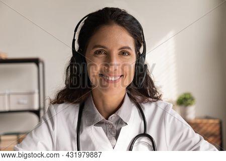 Happy General Practitioner In Headphones Giving Online Help