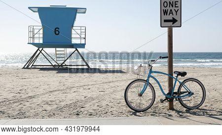 Blue Bicycle, Cruiser Bike By Sandy Ocean Beach, Pacific Coast, Oceanside California Usa. Summertime