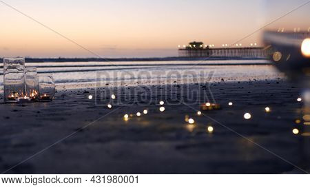 Candle Flame Lights In Glass, Romantic Beach Date, California Ocean Waves, Sea Water. Candlelight Se