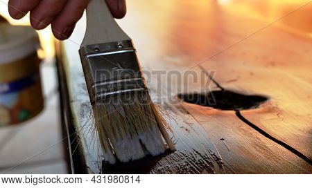 Applying Varnish To The Surface Of Vintage Wooden Furniture, Close-up Of A Brush Applying Varnish To
