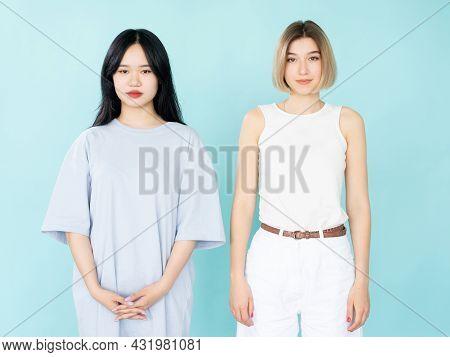 Female Friends. Smart Casual Look. Model Shooting. Pretty Asian And Caucasian Women In Modern Classi