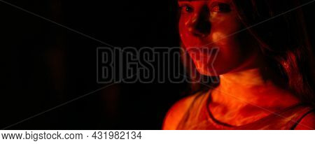 Art Portrait. Woman Empowerment. Gender Equality. Young Pretty Lady In Bright Red Color Art Abstract