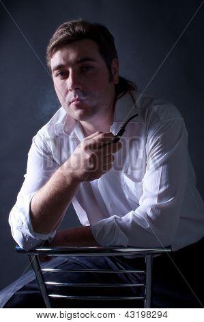 Young Beautiful Man Smoking A Pipe