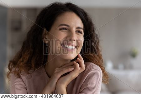 Joyful Attractive Young Latin Woman Daydreaming, Looking In Distance.