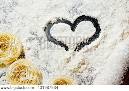 Heart Of Flour And Rolling Pin On Black Background. Top View, Copy Space