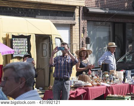Sint Gillis Waas, Belgium, 04 September 2021, Man Films Or Takes A Picture With His Mobile Phone At