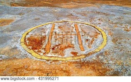 Old Corroded Helipad At Abandoned Mine, Industrial Background With Spots Of Rust Over Grey Rough Sur