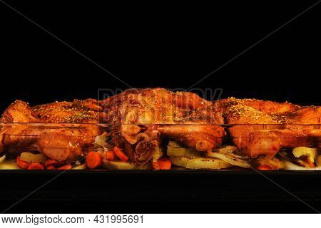 Raw Marinated Chicken Legs Are Cooked In The Oven. Chicken In Spices In A Juicy Sauce Is Fried