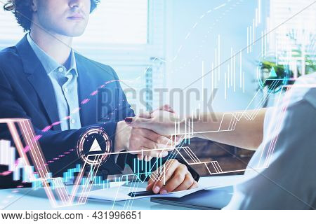 Businessman Wearing Formal Suit Is Shaking Hands With Businesswoman. Office Workplace In The Backgro