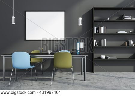Horizontal Canvas On The Wall Of The Grey Office Interior With Blue And Green Chairs, A Table, A She