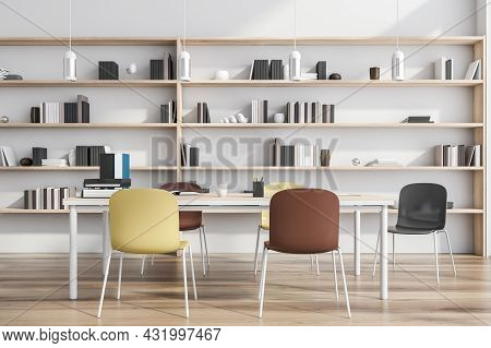 Creative Collaboration Table Interior With Bright Chairs, A Shelving Next To A White Wall, Parquet S
