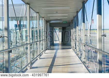 Passenger Boarding Bridge Pbb To Board Airplane. Boarding Gate Entrance To Train Station From Via Sk