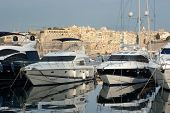 luxury yacht moored on Grand Harbour Marina on background dwelling of Senglea, Malta poster