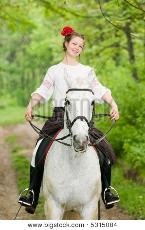 poster of Smiling girl riding horse in the forest