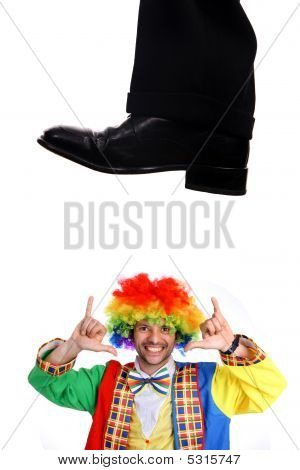 Business Shoe Steping And Destroying a clown