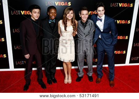 NEW YORK- OCT 29: Actress Olivia Struck (c) and cast members attend the premiere of 'Last Vegas' at the Ziegfeld Theatre on October 29, 2013 in New York City.