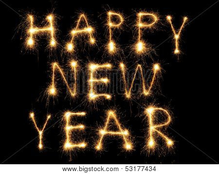 Happy New Year formed from sparking letters over black background poster