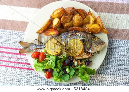 Fish, salad and patato