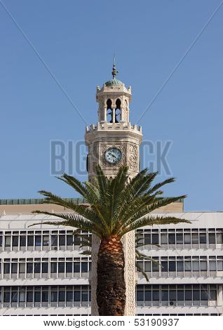 Fragment of Ancient clock tower (Saat Kulesi) with palm on front at Konak square in Izmir Turkey poster