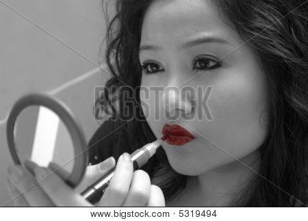 Woman Applies Makeup