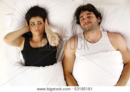 Man Snoring Keeping Woman Awake In Bed