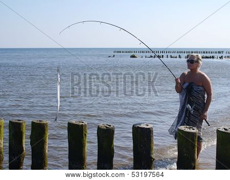 woman with fish and fishing-rod