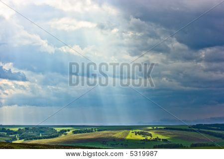 Rural Landscape With Sun Beams.