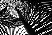 Metal modern spiral staircase details. Monochrome photo poster
