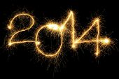 New Year 2014 formed from sparking digits over black background poster