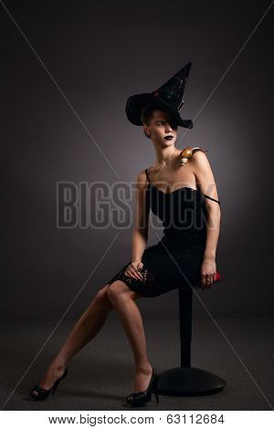 Portrait Of A Woman With Snail In Hat. Fashion. Gothic